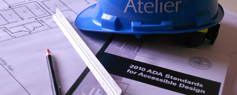 Hardhat with plans and ADA Standards manual