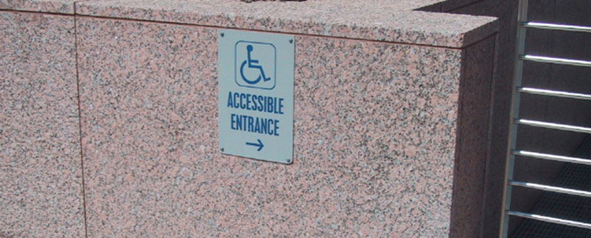Accessible entrance directional sign